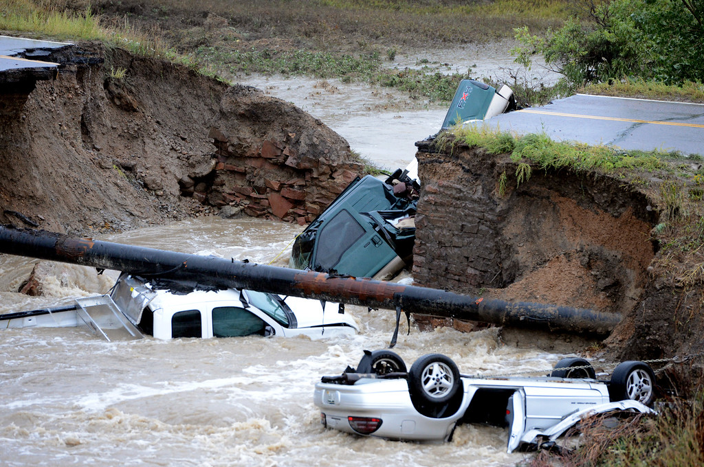 . A bridge collapse on a business access road at Highway 287 and Dillon Road in Lafayette causes 3 cars to fall in the creek. Cliff Grassmick / September 12, 2013