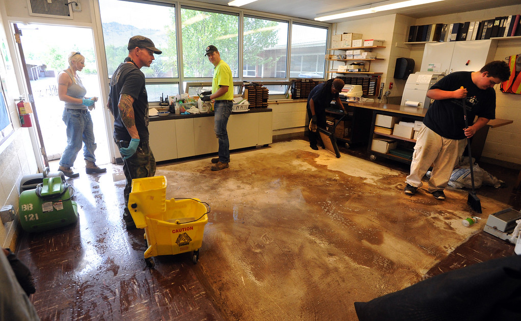 . Workers from Servpro and other disaster clean up contractors work on flood Damage in a classroom at Crest View Elementary in Boulder on September 17, 2013. For more flooding videos and photos, www.dailycamera.com. Cliff Grassmick  / September 17, 2013