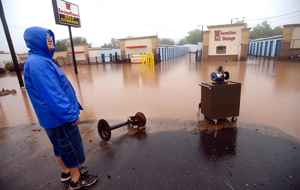 . David Platco looks over a flooded and damage storage facility in north Boulder Thursday morning.  Photo by Paul Aiken / www.dailycamera.com