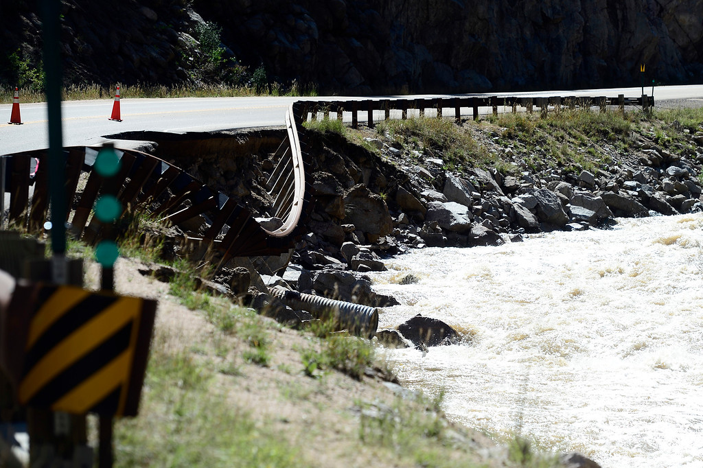 . A guard rail dips down to the creek where part Boulder Canyon Drive has been damaged by flooding in Boulder, Colorado September 18, 2013.  DAILY CAMERA/ MARK LEFFINGWELL