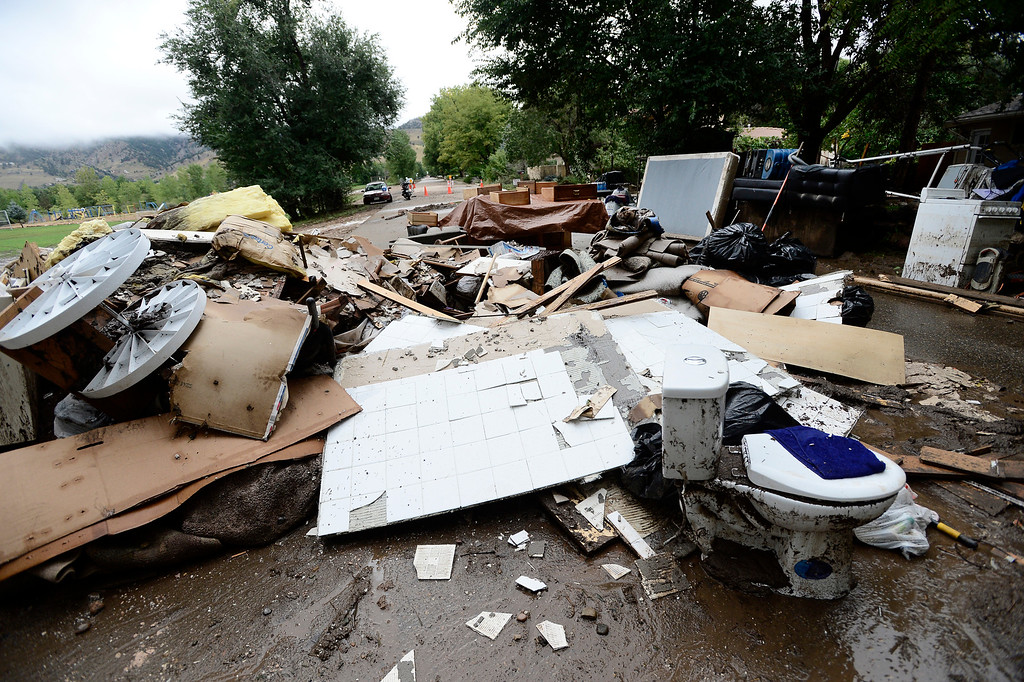 . Household items are outside a damaged house on Upland Drive in Boulder, Colorado on Sunday September 15, 2013.  Rain fell heavily again today increasing fears of more flooding in the community. Photo by Paul Aiken / The Daily Camera / Saturday September 15, 2013