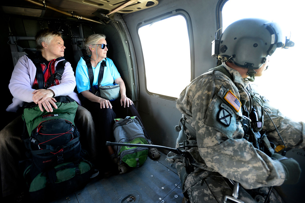 . Two women look out the window after rescued by a helicopter crew from Jamestown Colorado that was cut off by flood waters. The helicopter was flown by the 2-4 GSAB 4th Infantry Division based in Ft. Carson Colorado.  Tuesday September 17, 2013. BOULDER DAILY CAMERA/ Mark Leffingwell Leffingwell
