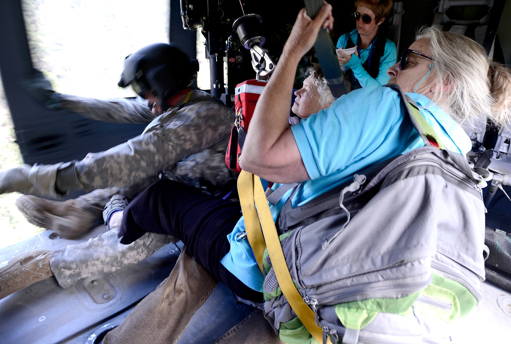 . Two women are rescued by a helicopter crew with the 2-4 GSAB 4th Infantry Division based in Ft. Carson near Jamestown, Colorado September 17, 2013. BOULDER DAILY CAMERA/ Mark Leffingwell