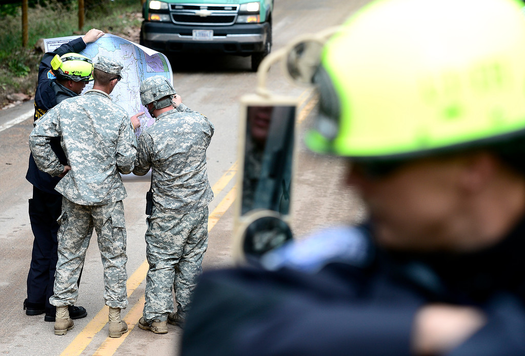 . Members of the a FEMA Urban Search & Rescue team and Colorado National Guard check a map to begin checking homes off of Lee Hill Drive in Boulder, Colorado September 16, 2013.  DAILY CAMERA/ MARK LEFFINGWELL