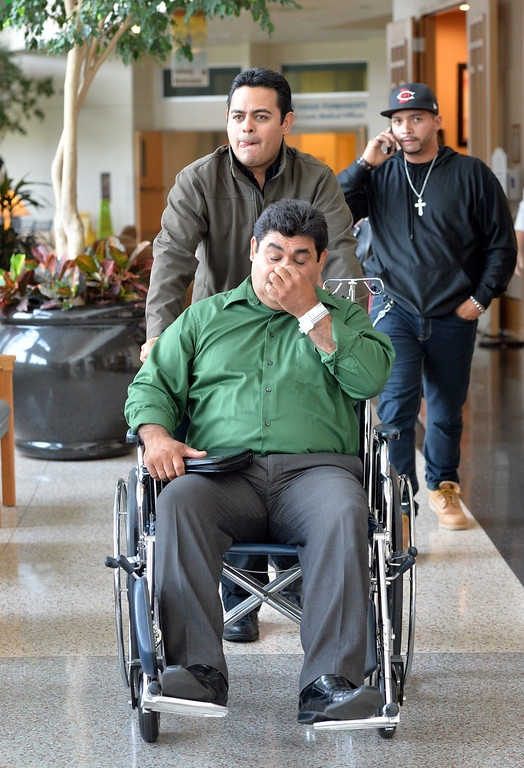 . Roy Ortiz  is wheeled out of Good Samaritan Hospital on Friday by his brother Pedro Ortiz after giving a news conference on Friday. Roy Ortiz survived being trapped in his car in the water of Rock Creek after a section of Dillon Road collapsed on Thursday. September 13, 2013 staff photo/ David R. Jennings