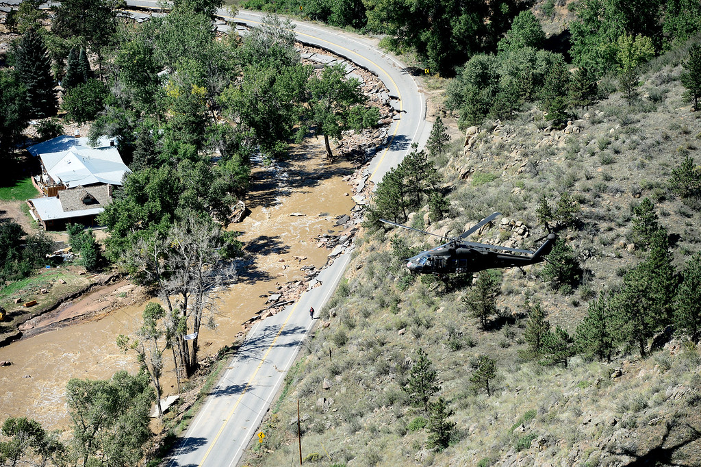 . A rescue helicopter flies over Lyons, Colorado which was hard hit by flood waters. The aircraft was flown by the 2-4 GSAB 4th Infantry Division based in Ft. Carson, Colorado.  Tuesday September 17, 2013. BOULDER DAILY CAMERA/ Mark Leffingwell