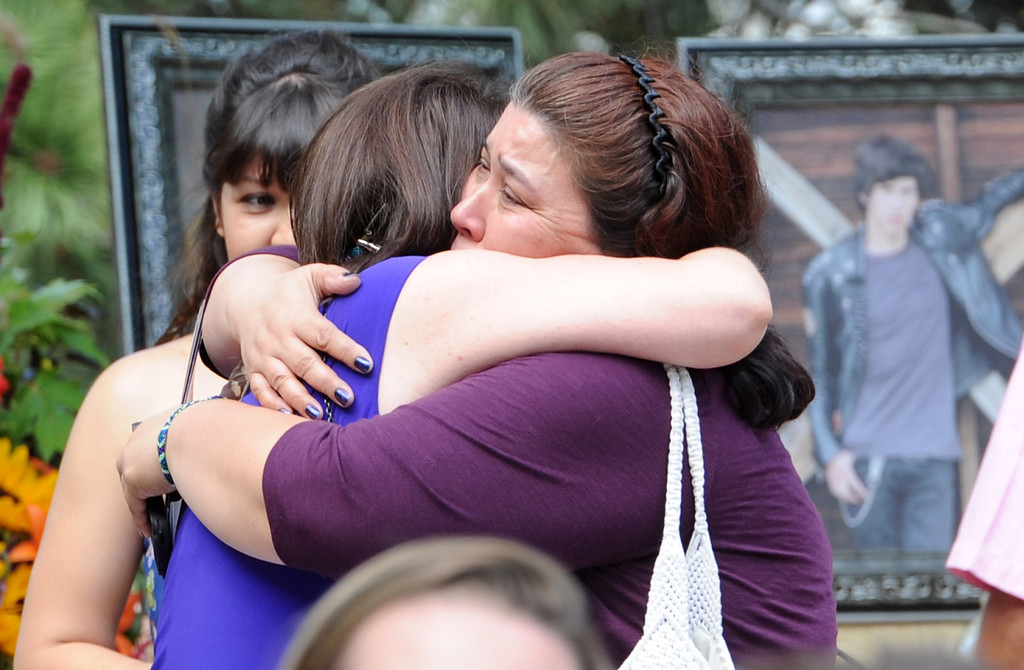 . Glenda Aretxuloeta, left,  hugs Jennifer Nelson, they are the mothers of Wesley and Wiyanna, respectively. A memorial service for Wiyanna Nelson and Wesley Quinlan was held at NCAR in Boulder, Colorado  on Saturday, September 21, 2013. The teenagers were killed in the flood waters in Boulder last week.  Cliff Grassmick  / September 21, 2013