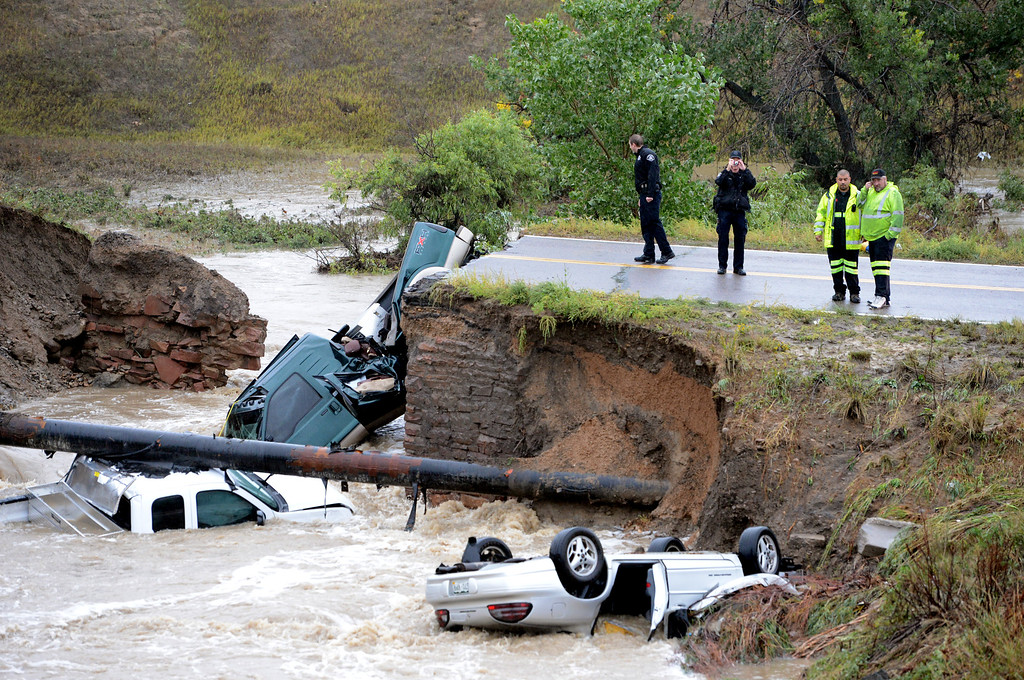 . A bridge collapse on a business access road at Highway 287 and Dillon Road in Lafayette, Colorado, causes 3 cars to fall in the creek. Cliff Grassmick / September 12, 2013