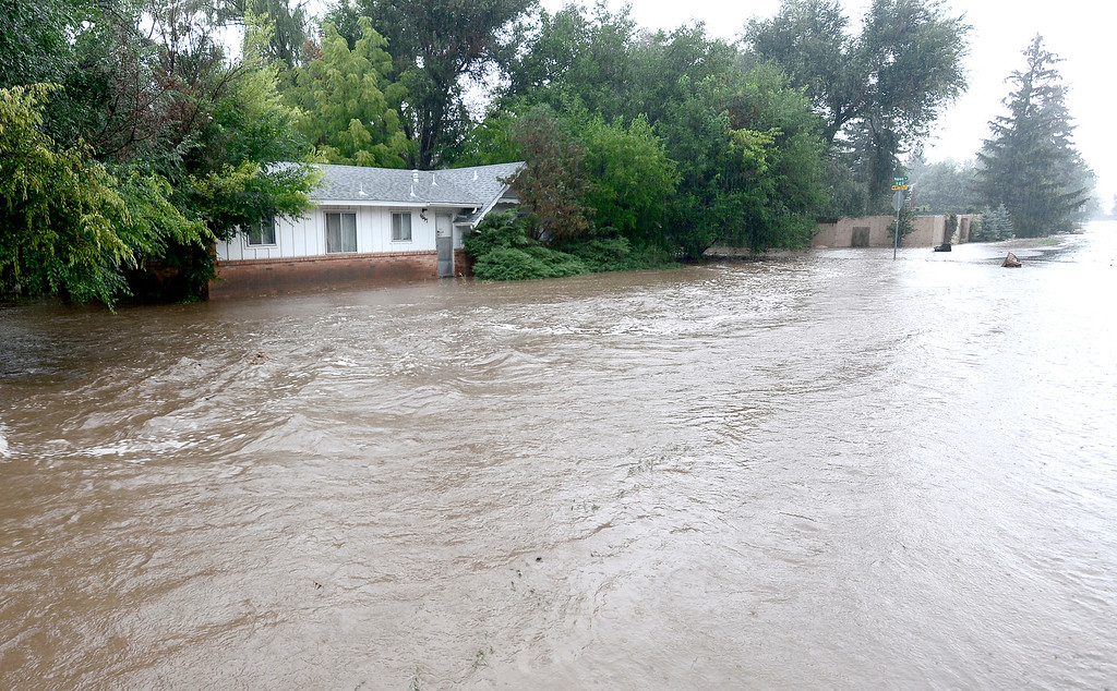 . A home at 16th and Topaz is surrounded by flood waters as heavy rains cause flooding in Boulder, Colorado September 12, 2013. BOULDER DAILY CAMERA/ Mark Leffingwell