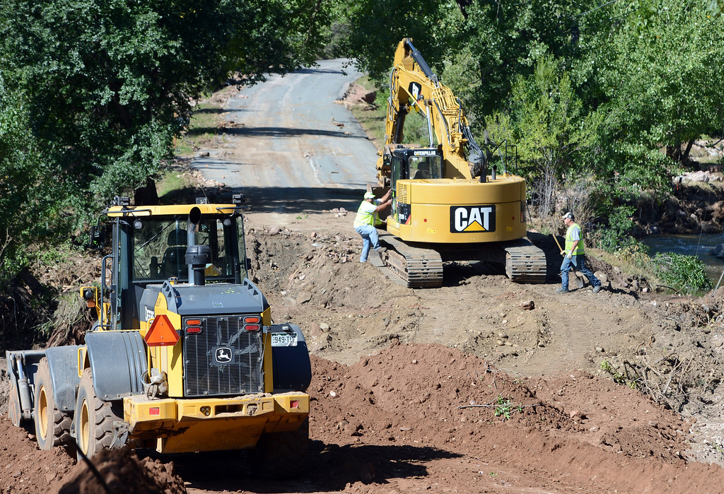 . Boulder County Road crews repair a washed out  Wagonwheel Gap Road off Lee Hill Drive, so that Xcel can begin work on gas and power lines. For a video of the construction, go to www.dailycamera.com. Cliff Grassmick  / September 20, 2013