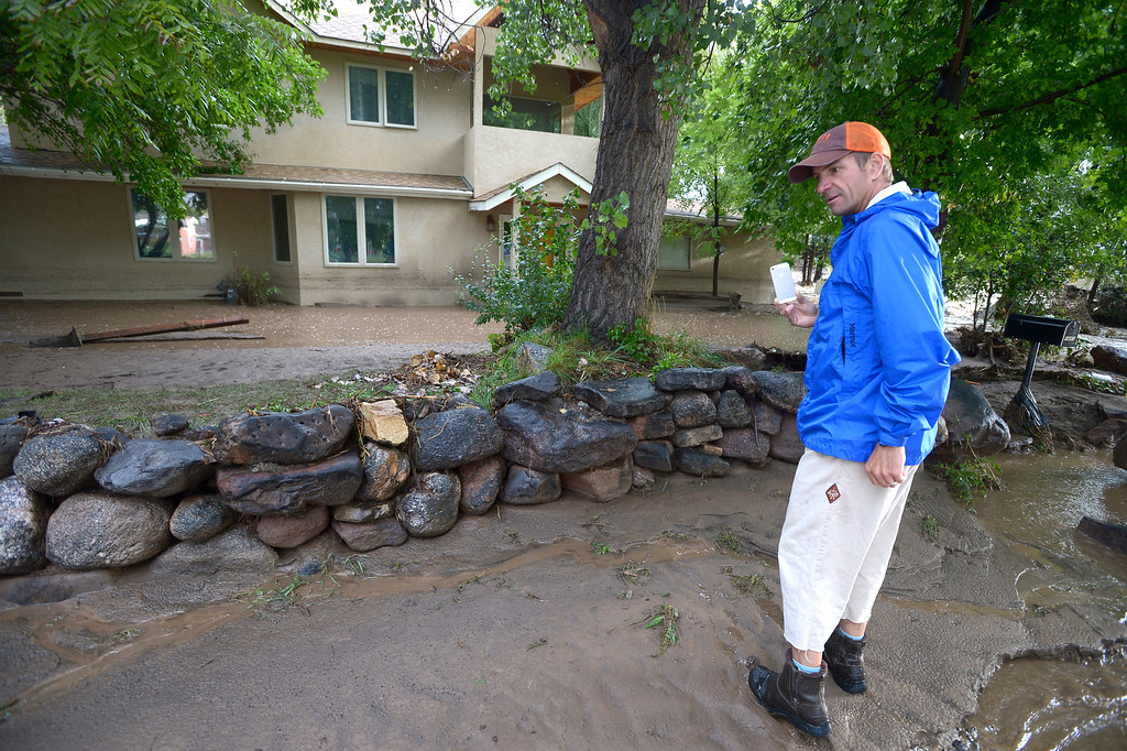 . Greg Ask looks over flooded home in North Boulder at the corner Upland and 19th Street on Friday morning.  Photo by Paul Aiken