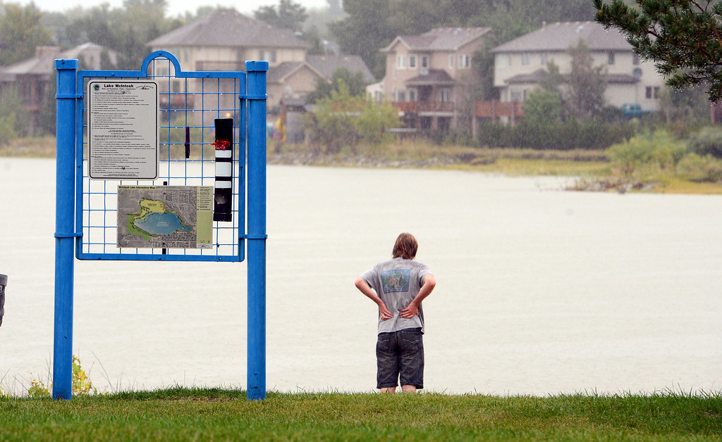 . A  resident looks  over  McIntosh Lake Sunday afternoon in Longmont, Colorado on September 15, 2013. Cliff Grassmick / September 14, 2013