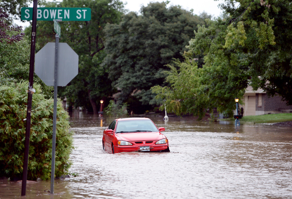 . Lefthand Creek in Longmont has flooded a block in each direction on S. Bowen Street on Friday. This car is parked on Lefthand Drive. For more flooding videos and photos, www.dailycamera.com. Cliff Grassmick  / September 13, 2013