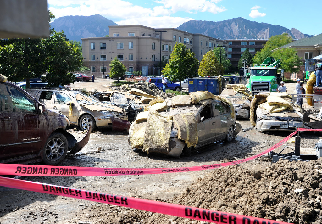 . Cars located in the underground parking at the Frasier Meadows complex in Boulder  were completely covered in mud and water and are being removed on Tuesday. For more flooding videos and photos, www.dailycamera.com. Cliff Grassmick  / September 17, 2013
