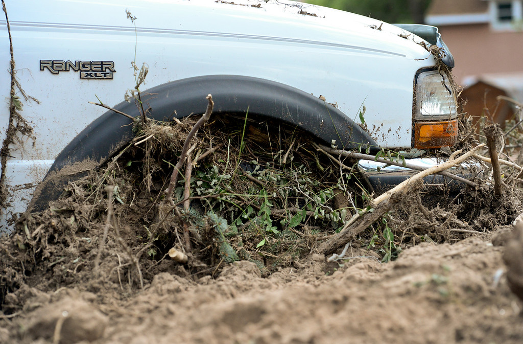 . Mud and debris fills the wheel well of a pickup truck, Wednesday, Sept. 18, 2013, in Lyons. (Matthew Jonas/Times-Call)