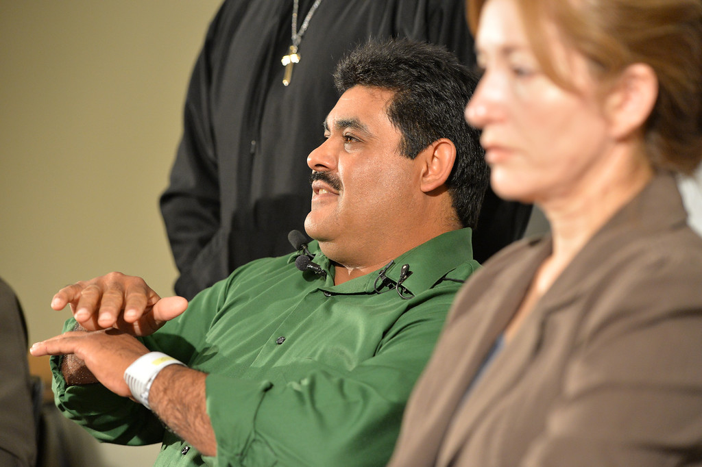 . Roy Ortiz explains how he survived his car crashing into the water at Dillon Road last Thursday, during a news conference at Good Samaritan Hospital on Friday. Ortiz wife Patricia, right, listens during the conference.   September 13, 2013 staff photo/ David R. Jennings