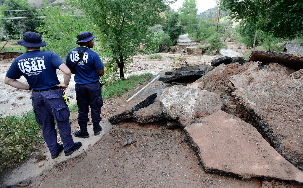 . FEMA Urban Search and Rescue Personnel look over a washed out bridge and damaged home at the intersection of Wagonwheel Gap Road and Lee Hill Drive inBoulder, Colorado. Several homes along the Fourmile Canyon Creek were destroyed or heavily damaged. The FEMA personnel refused to be identified. Paul Aiken / The Daily Camera / Monday  September 16, 2013