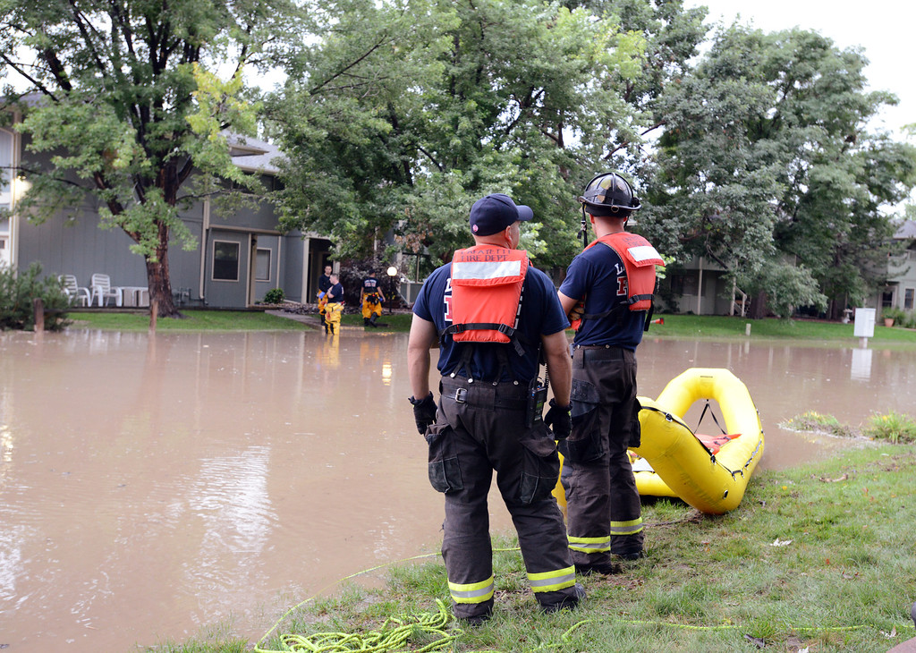 . Lafayette Fire firefighters stand by to help in an non voluntary evacuation of the Centaur Circle area in Lafayette  on Thursday. September 12, 2013 staff photo/ David R. Jennings
