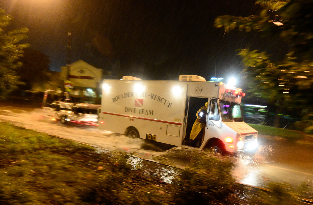 . A Boulder Fire-Rescue Dive team truck passes through a flooded section of 28th near Pearl, Thursday, Sept. 12, 2013, in Boulder. (Matthew Jonas/Times-Call)
