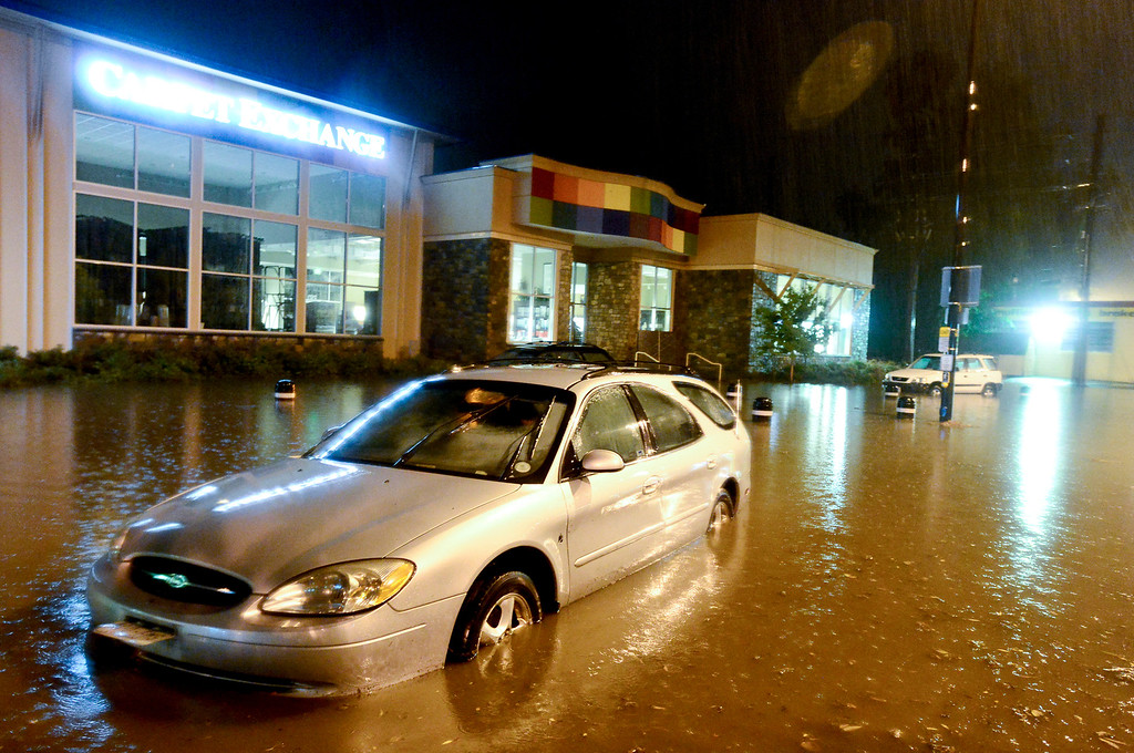 . Stalled vehicles are seen floating on 28th near Pearl, Thursday, Sept. 12, 2013, in Boulder. (Matthew Jonas/Times-Call)