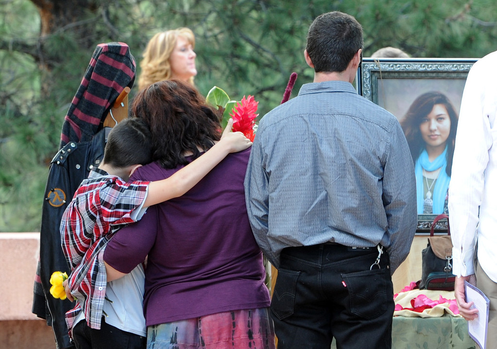 . Bejamin Nelson, his mother, Jennifer, and father, Ron, look at the portrait of their daughter and sister, Wiyanna Nelson. after the service. A memorial service for Wiyanna Nelson and Wesley Quinlan was held at NCARin Boulder, Colorado on Saturday, September 21, 2013. The teenagers were killed in the flood waters in Boulder. Cliff Grassmick  / September 21, 2013