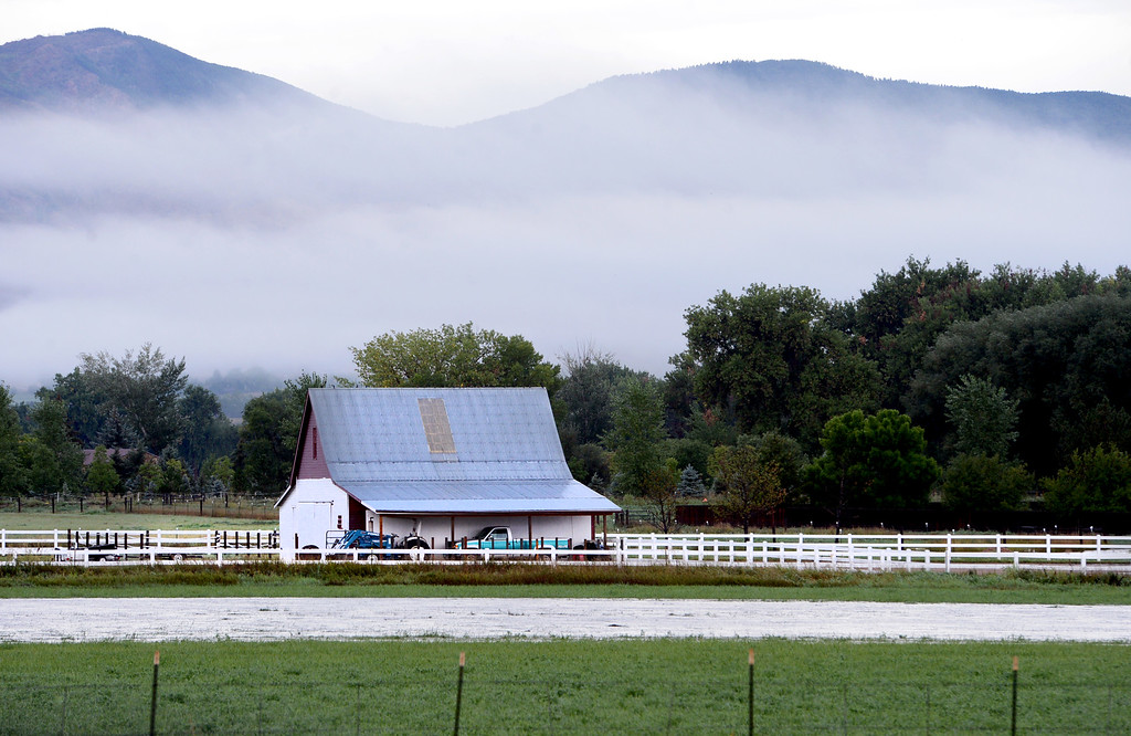 . Fog can be seen behind this barn near Niwot along the Diagonal Highway. For more flooding videos and photos, www.dailycamera.com. Cliff Grassmick  / September 13, 2013