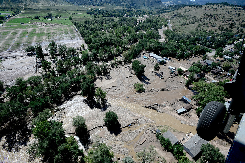 . A rescue helicopter flies over Lyons Colorado which was hard hit by flood waters. The aircraft was flown by the 2-4 GSAB 4th Infantry Division based in Ft. Carson, Colorado.  September 17, 2013. BOULDER DAILY CAMERA/ Mark Leffingwell