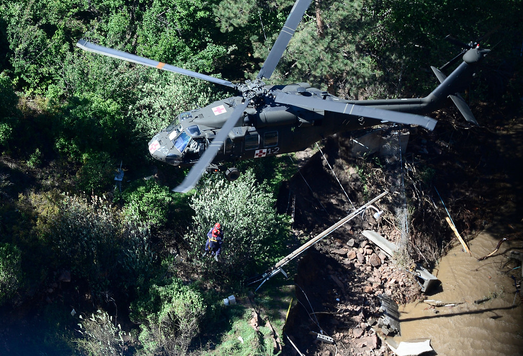 . A Blackhawk helicopter rescues people in need of help in Lyons, Colorado September 17, 2013. BOULDER DAILY CAMERA/ Mark Leffingwell