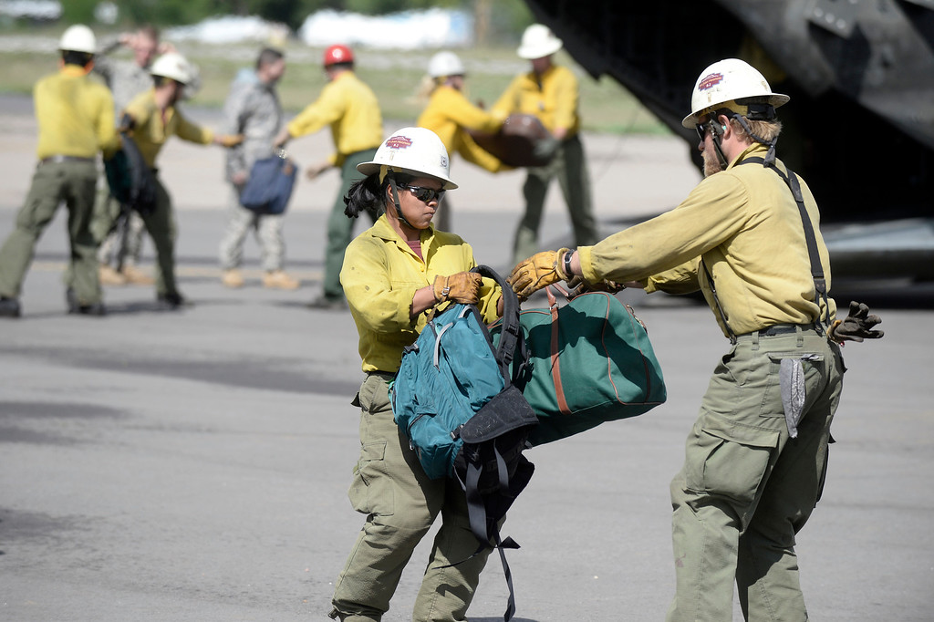 . Rescue workers carry peoples belongings after they were rescued by helicopter from the flooded areas on Monday, Sept. 16, at the Boulder Municipal Airport in Boulder. For more photos and video of the flood rescue go to www.dailycamera.com Jeremy Papasso/ Camera