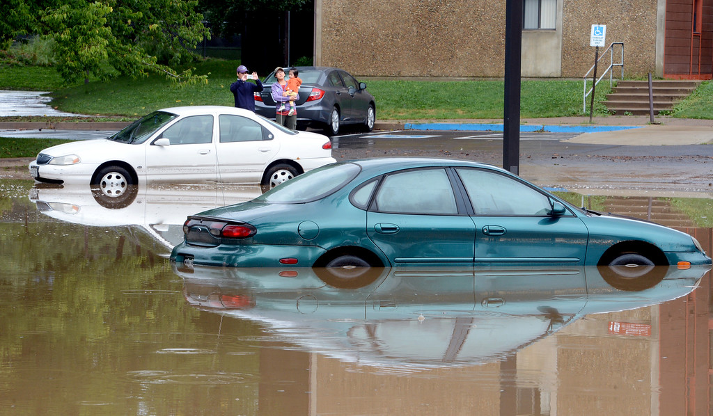 . The parking lot at CU married housing off Folsom is completely flooded on Friday. For more flooding videos and photos, www.dailycamera.com. Cliff Grassmick  / September 13, 2013