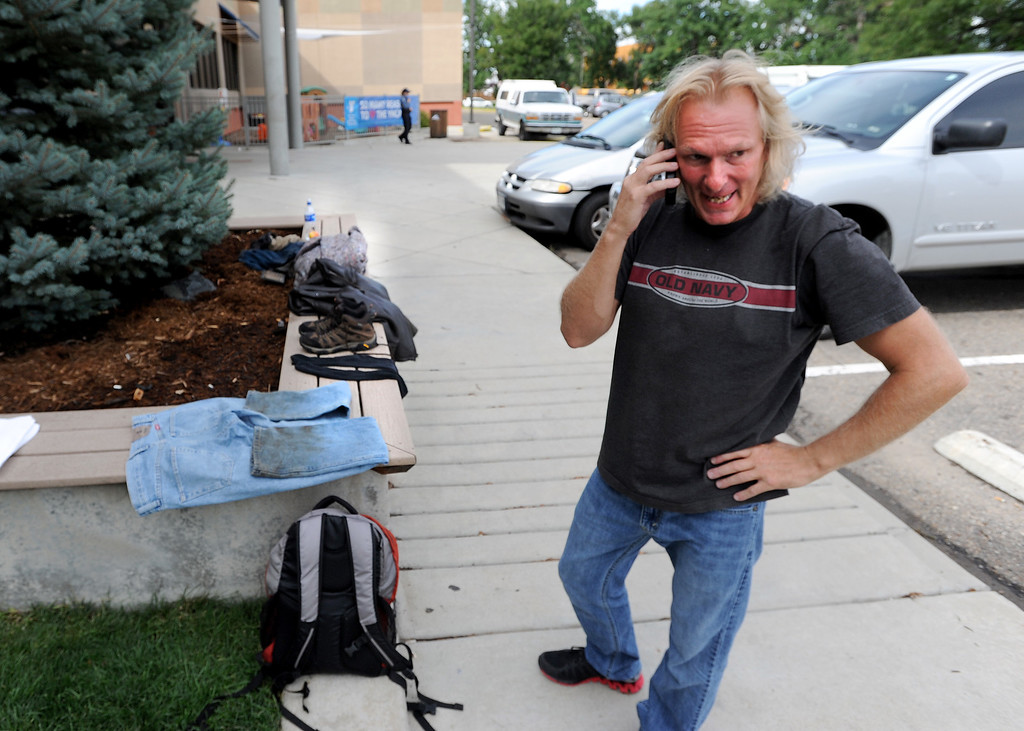 . Tim Robbins talks to his family to let them know he was safe. He is one of the evacuees at the Boulder YMCA on Mapleton. For more flooding videos and photos, www.dailycamera.com. Cliff Grassmick  / September 13, 2013