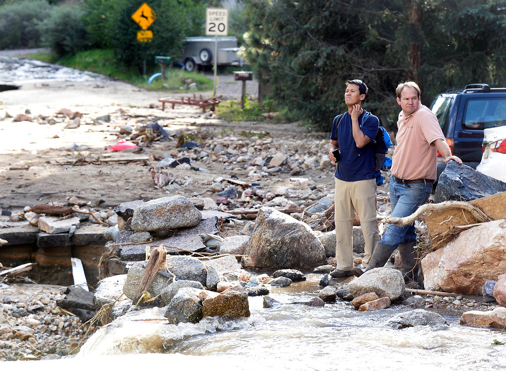 . Keenan Gates, at left, and Caleb Edelman, of ECOS Environmental and Disaster Restoration, assess the destroyed home of Gates mother  on Tuesday, Sept. 17, in the town of Salina on Fourmile Canyon Drive in Boulder County. For more photos and video of the flood rescue go to www.dailycamera.com Jeremy Papasso/ Camera