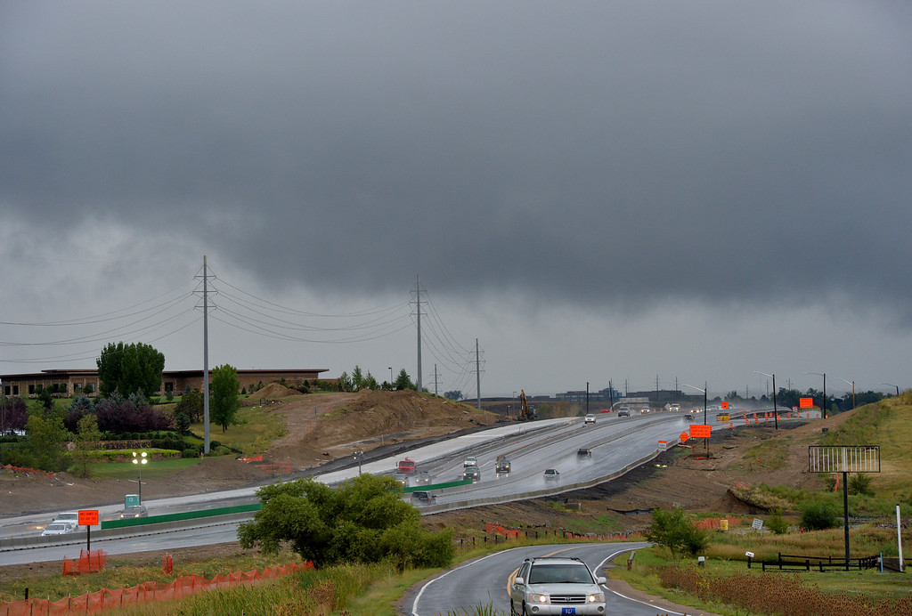 . Rain clouds hover over Boulder as seen from US 36 in Broomfield on Thursday.  September 12, 2013 staff photo/ David R. Jennings