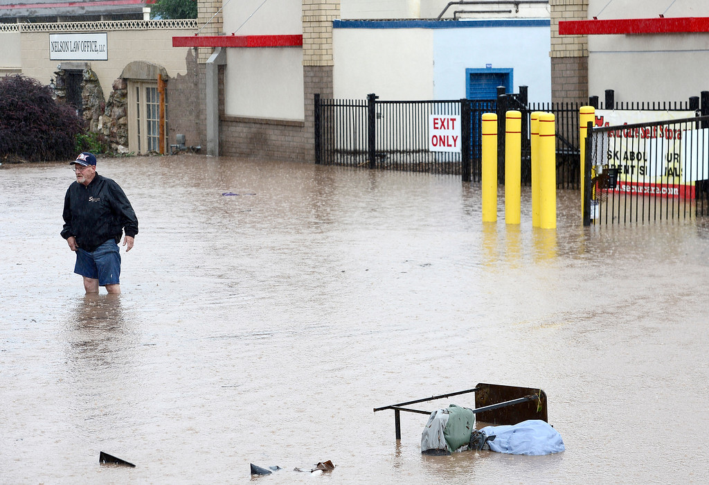 . Jack Templeton stands in knee deep water trying to access the storage facility he at after flooding from heavy rains has washed it out in Boulder, Colorado September 12, 2013. BOULDER DAILY CAMERA/ Mark Leffingwell