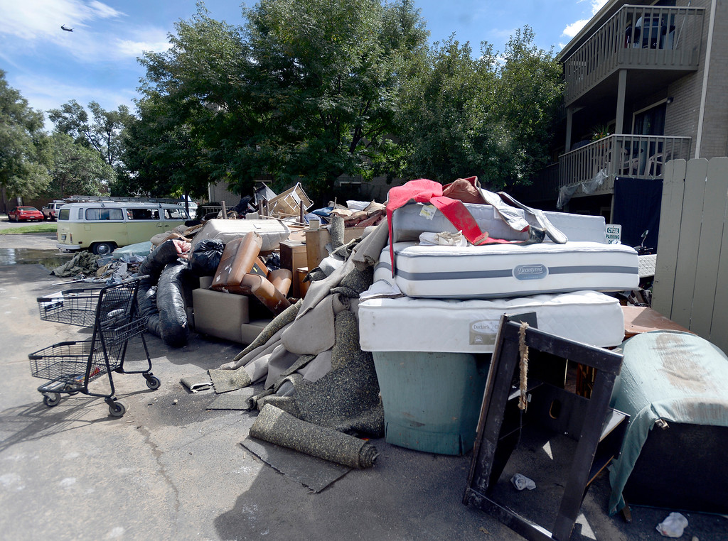 . Piles of flood damaged belongings sit outside of the Manhattan West Apartments on Wednesday, Sept. 18, in Boulder. For more photos and video of the flood go to www.dailycamera.com Jeremy Papasso/ Camera