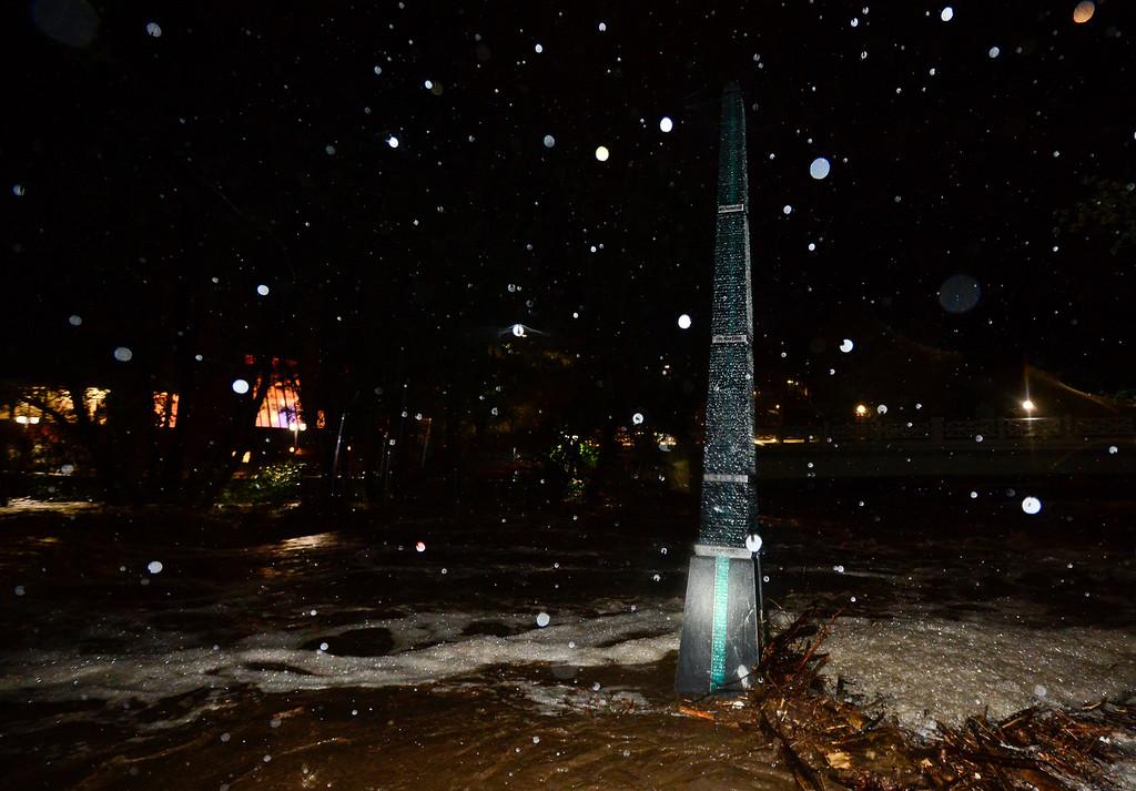 . Boulder Creek flows around a flood marker, Thursday, Sept. 12, 2013, near Broadway and 13th in Boulder. (Matthew Jonas/Times-Call)