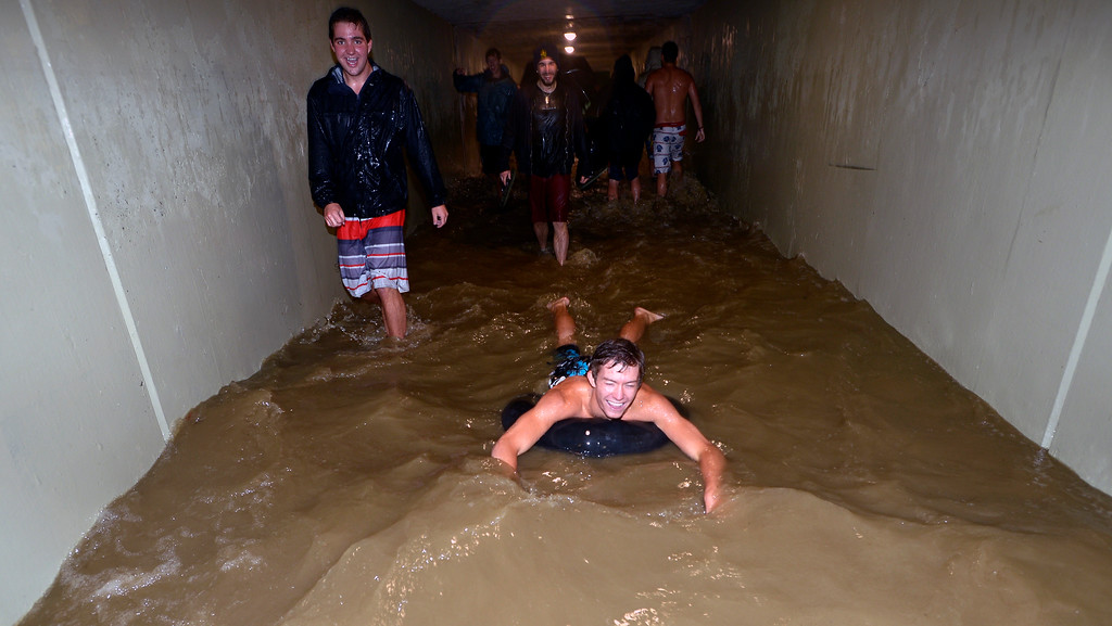 . Eddie Fundingsland rides a tube through the tunnel underpass at Colorado and 28th just off the CU Boulder Campus on Wednesday night. Photo by Paul Aiken / www.dailycamera.com