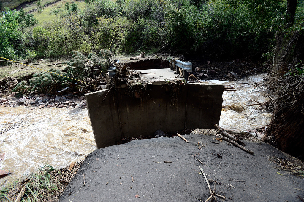 . A bridge is washed away in front of a heavily damaged home along the Fourmile Canyon Creek on Lee Hill Drive in Boulder Colorado Paul Aiken / The Daily Camera / Monday  September 16, 2013