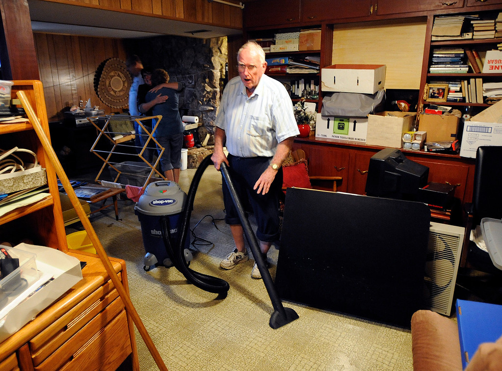 . Bob Rea is vacuuming water out of his basement on Thursday afternoon. Bob Rea, of Boulder, his family and friends, have been pumping water and cleaning the basement of their home since 9 pm last night. For more flooding videos and photos, www.dailycamera.com. Cliff Grassmick  / September 12, 2013