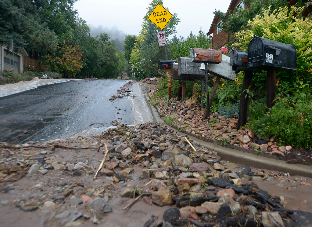 . Rocks and debri fill the roads on 4th Street during the heavy flooding on Thursday in Boulder. For a video of the flooding go to www.dailycamera.com  Jeremy Papasso/ Camera
