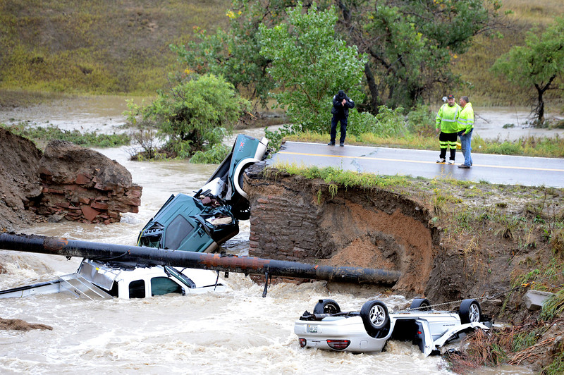 Bridge Out Car in Creek from Rain32  Bridge Out Car in Creek fro