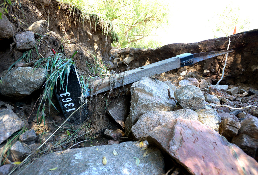 . A mailbox is in a sinkhole after the flood on Tuesday, Sept. 17, in the Fourmile Canyon area of Boulder County.  Jeremy Papasso/ Camera
