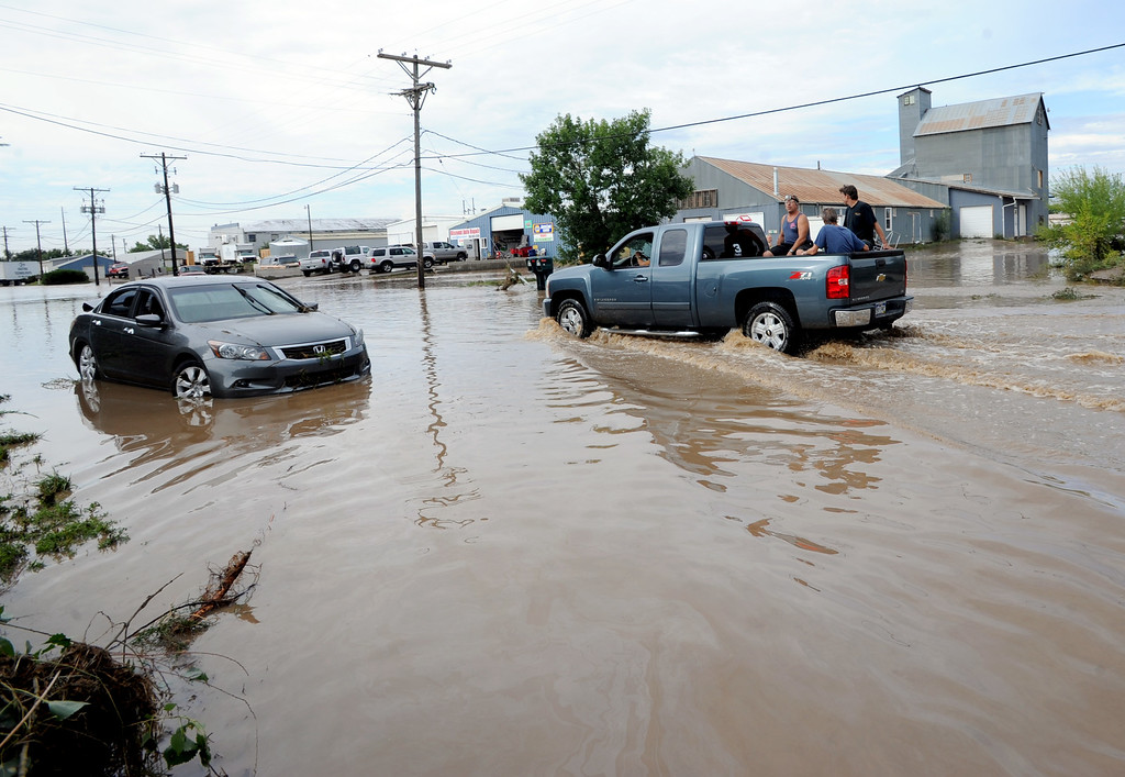 . S. Bowen Street near 1st Ave in Longmont still has about a foot of water Saturday morning. Cliff Grassmick / September 14, 2013