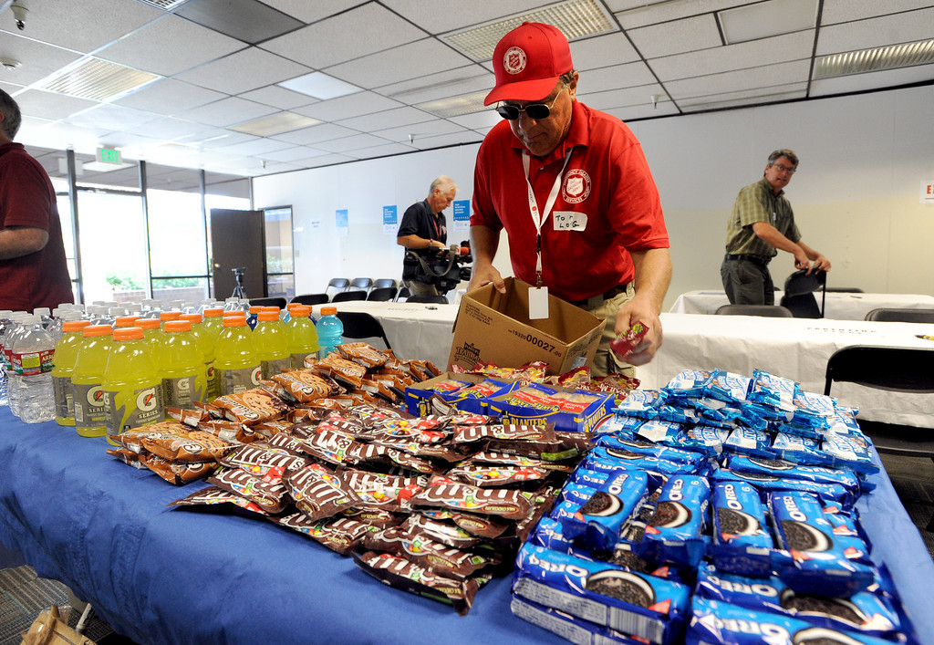 . Tom Long of the Salvation Army in Arizona, sits out food for evacuees at the center on Thursday. The City of Boulder and Boulder County are opened a joint Disaster Assistance Center at 1 p.m. on Thursday, Sept. 19, at 5495 Arapahoe Ave. in Boulder. This center, along with the Disaster Assistance Center in Longmont, is available all to Boulder County residents impacted by the flood.For more flooding videos and photos, www.dailycamera.com. Cliff Grassmick  / September 19, 2013