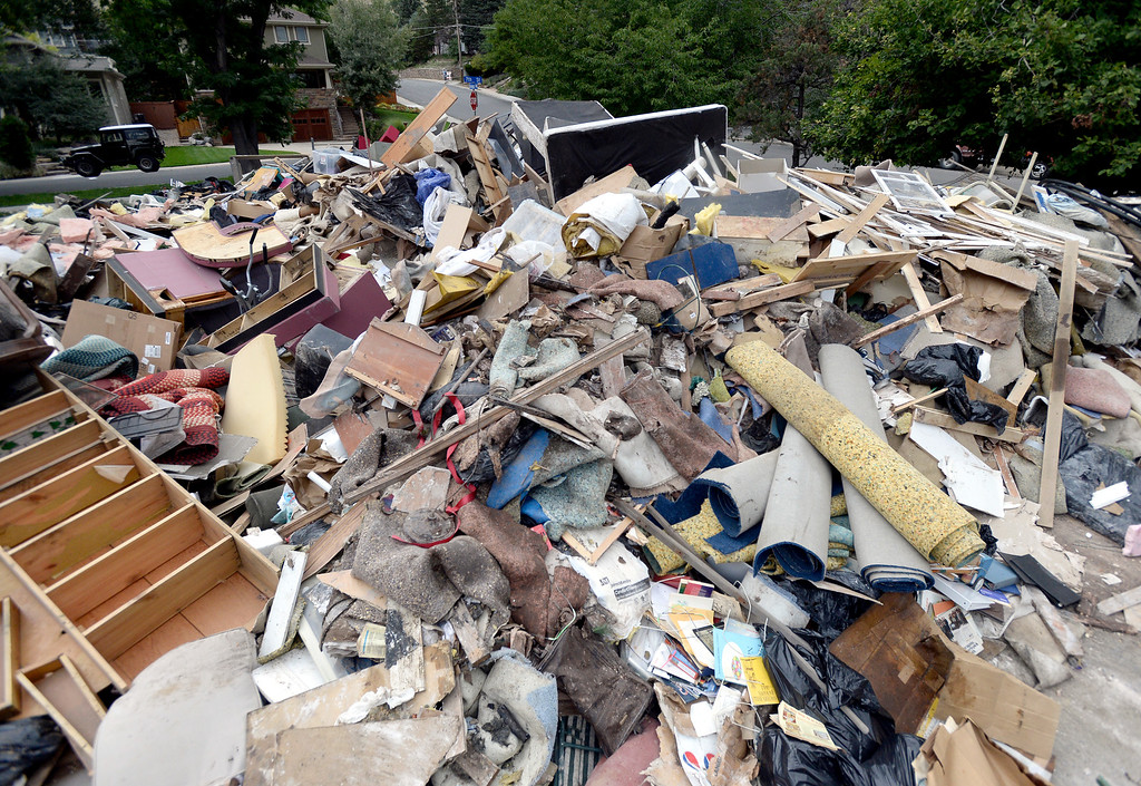 . A massive pile of flood damaged property sits in the parking lot of the North Boulder Park on Wednesday, Sept. 18, in Boulder. For more photos and video of the flood go to www.dailycamera.com Jeremy Papasso/ Camera