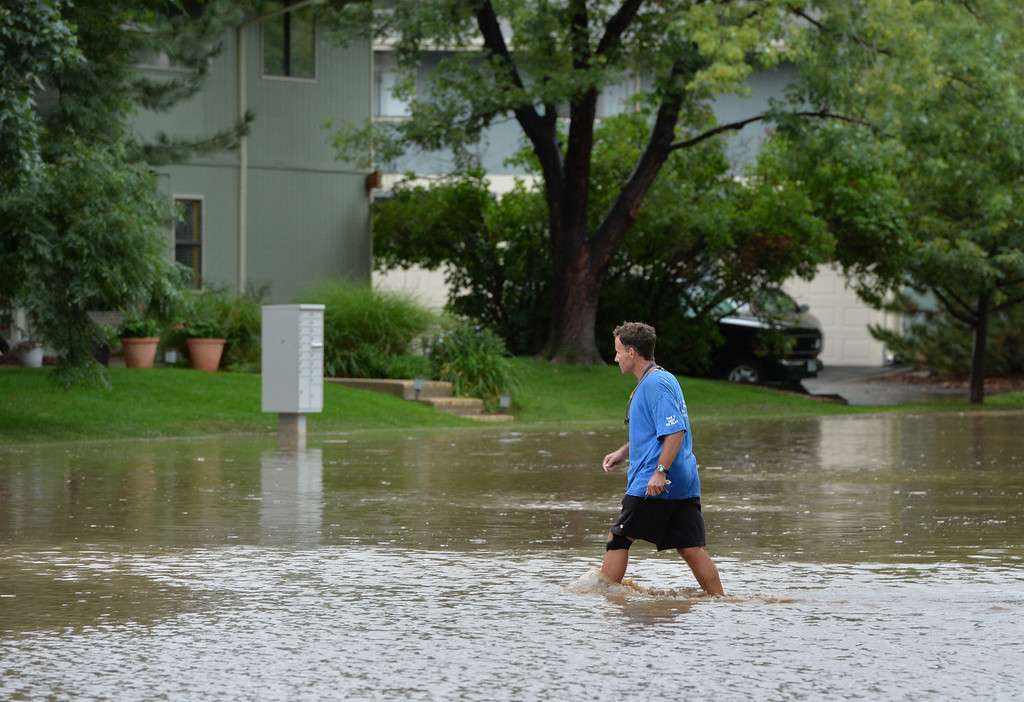 . A Man walks across Centaur Circle to his home during a non voluntary evacuation of the Centaur Circle area in Lafayette  on Thursday. September 12, 2013 staff photo/ David R. Jennings