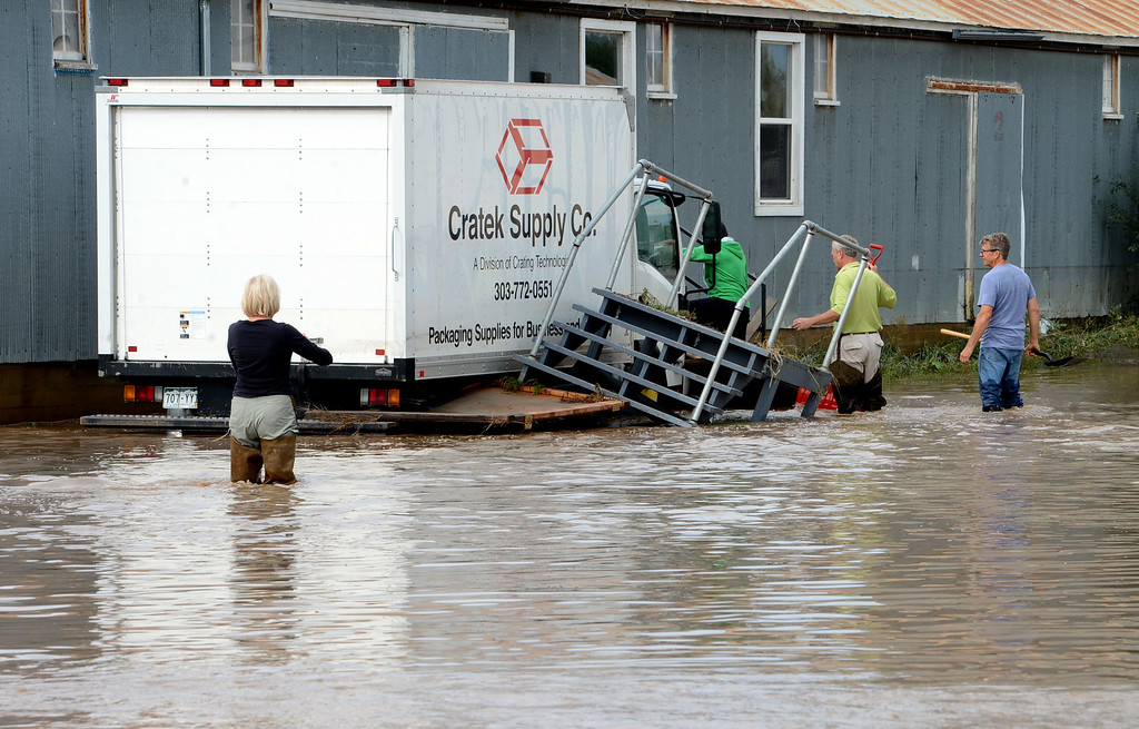 . People try to enter a business near 1st Ave. and S. Bowen in Longmont, Colorado, on September 14, 2013. Cliff Grassmick / September 14, 2013