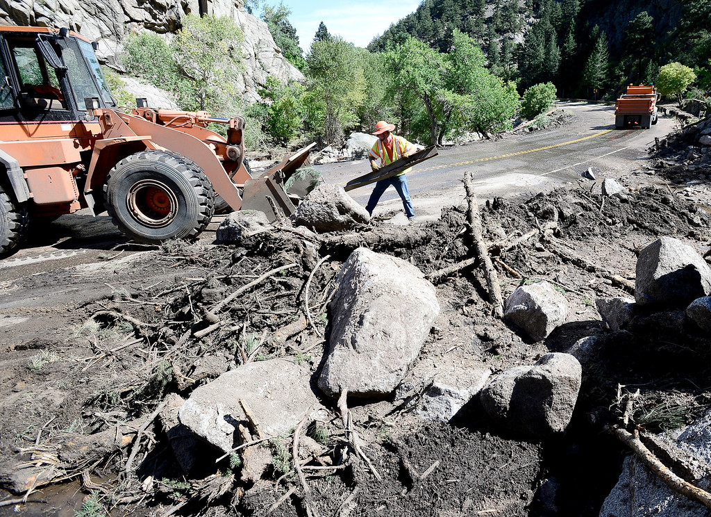 . Members of CDOT work to clear Boulder Canyon Drive after flood waters left road damage and debris along Boulder Canyon Drive in Boulder, Colorado September 18, 2013.  DAILY CAMERA/ MARK LEFFINGWELL