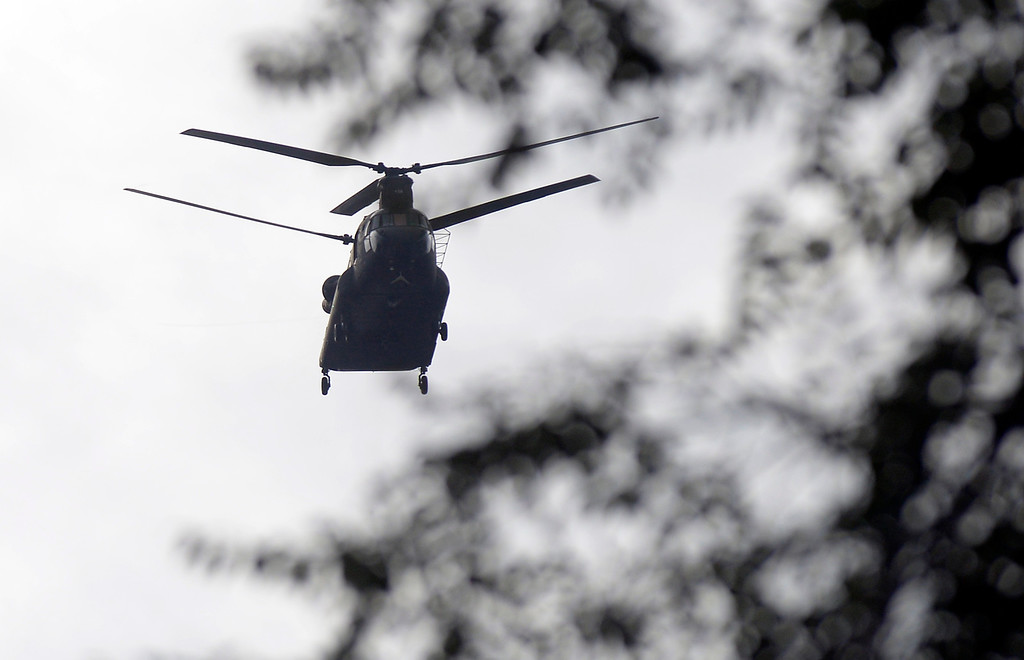 . A military helicopter flies overhead to rescue stranded residents on Saturday, Sept. 14, in Boulder. For more photos and video of the flood rescue go to www.dailycamera.com Jeremy Papasso/ Camera
