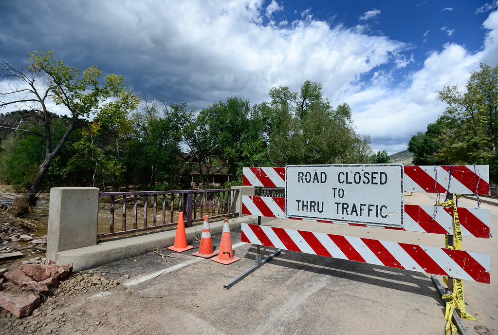 . A road closed sign is seen blocking one lane of the 5th Avenue bridge near Evans Street, Wednesday, Sept. 18, 2013, in Lyons. (Matthew Jonas/Times-Call)